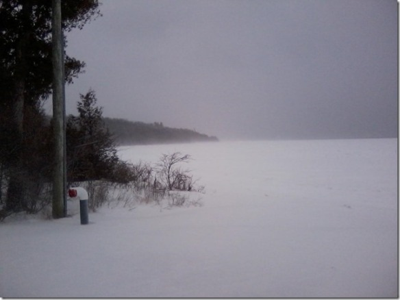 "From Yvonne:  I call this my ""angry"" picture. This is in the middle of the day by the British Landing and the wind was so strong that it was whipping the ice and snow around creating an almost whiteout. The noise was so loud that it sounded like the lake being angry and screaming at me. It was somewhat eerie being out there by myself."