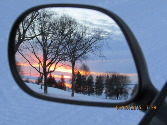 A Mackinac sunset through Bruce LaPine's rear view mirror.