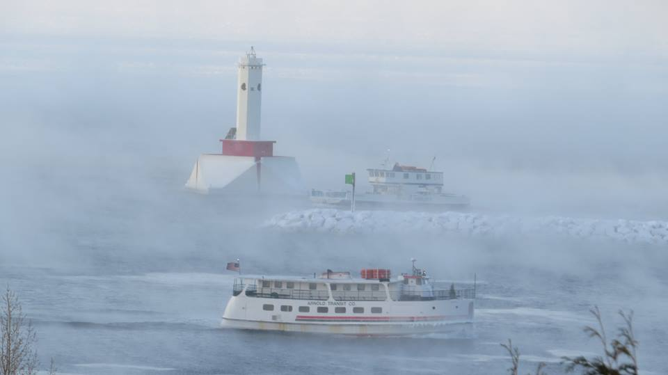 From Clark Bloswick - The ferry service is day to day now, as the water freezes.  On this day Arnold Line's Mighty Huron had to come into harbor by going around the back of the island.  Shepler's Sacre Bleu managed to make it straight in from St. Ignace.