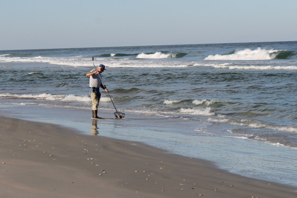 """As we walked further north, we spotted this gentleman standing just where the waves were coming in.  I wondered what he might be doing, and Ted said, """"I think he's catching sand fleas.""""  Sand fleas?  """"Why would you want to catch a flea - sand or otherwise?""""  Ted found that very funny."""