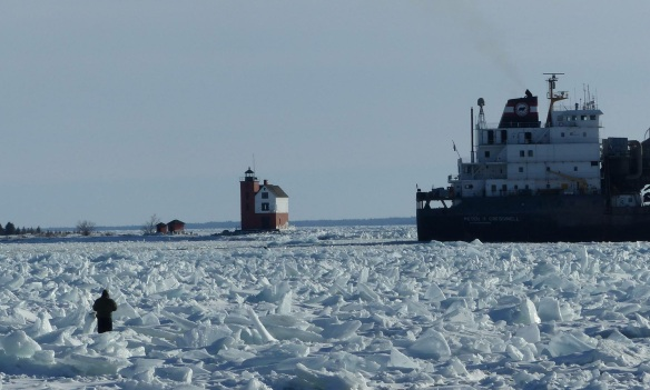 Oh, and speaking of Robert McGreevy.  That's him standing out there on the ice trying to get some of those great photos he shares!  The ship is the Peter R. Cresswell.  (Photo:  Molly McGreevy)