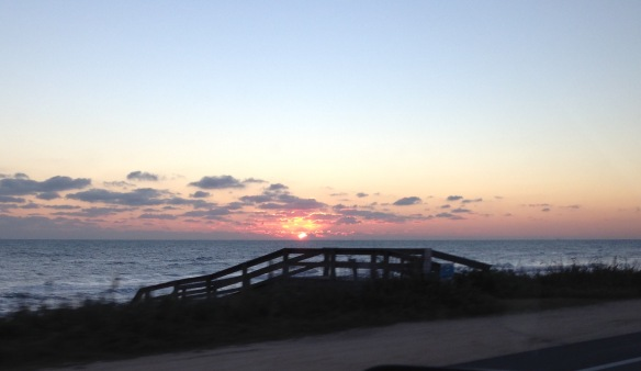 On the way to Bear's teeth cleaning appointment I pulled over to get this photo of the sun coming up over the Atlantic.