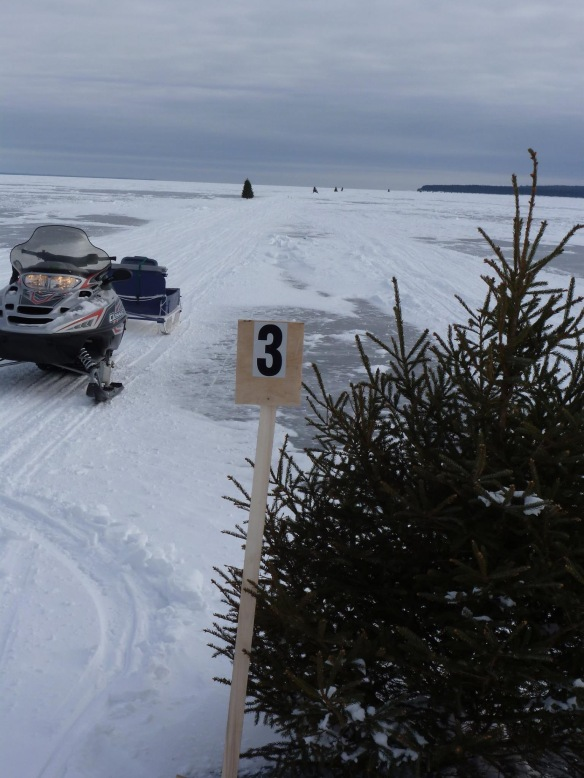 "Ok.  Totally awesome and brilliant idea from islander Jason St. Onge (pic by Clark Bloswick).  Jason has put up ""reference point"" markers along the ice bridge this year.  These will make it so much safer for those who choose to travel across the ice AND for first responders who are called out to help those who get in trouble out there.  Instead of having to ""count trees"" to tell someone your location (""I'm just past Christmas tree 33, you know - the one that the third branch from the top is broken?"").  NOW, it'll be ""I'm just beyond Marker 3"".  The markers have the same number coming and going, by the way.  They are actually mile markers, but reference points!"