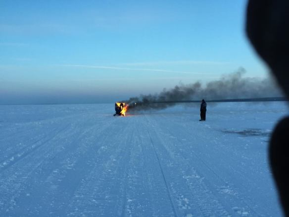 She hadn't gotten very far, when her snowmobile caught on fire!  She was able to get off and get away from it and wasn't injured in any way!  (Photo: Josh Carley)