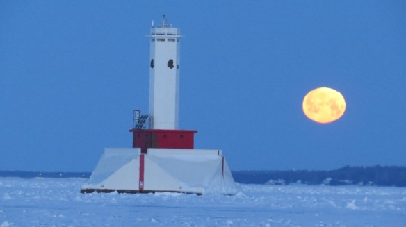 . . . followed by Clark's Thursday morning shot of the moon setting.