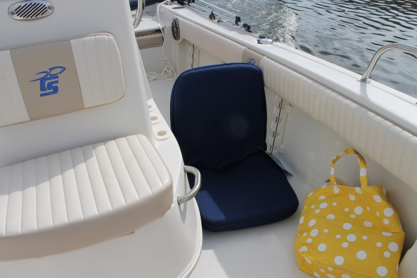 . . . and we're adding a few accessories to make it more comfortable - like this boat seat with a back that lets up and down.
