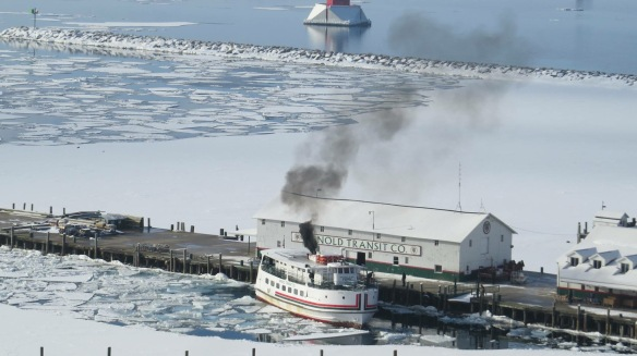 Nothing is as exciting to islanders who have endured another cold, isolated winter as the first ferry making it to the dock.  Arnold's mighty Huron made it in after almost two days of slamming through the ice between St. Ignace and Mackinac