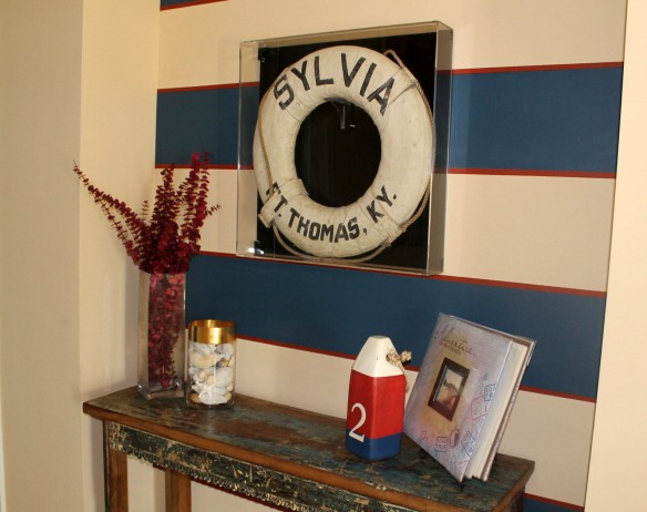 The Sylvia's life preserver hangs in an acrylic shadow box.  The album sitting upright on the stand is an unbelievable piece of history for Ted and his family. It is the personal diary of Ted's grandmother of the trip on the Sylvia from Virginia to Michigan.  She tells in vivid detail about each day of the voyage - what they did, what they ate, where they put into port, etc.  On board were Arthur, Ruth, five children, and the children's grandmother.  What a trip that was!