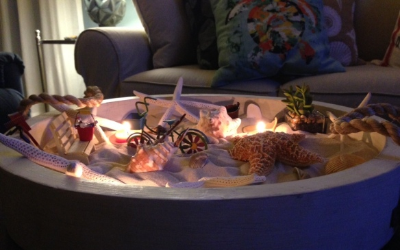 At night I throw in 2-3 votive candles, and the sand box turns into a moonlit beach.