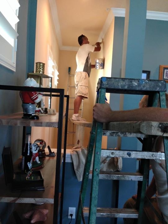 Nerves of steel!  Warranty folks doing some touch up painting in our stairwell . . .