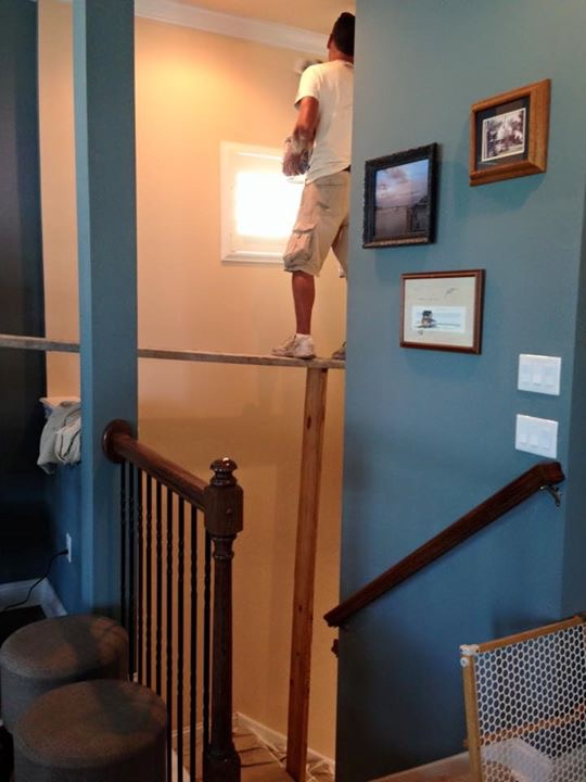 . . . that board is balanced between a second floor ledge and a ladder, with a board pryed under it for support.  Good grief!