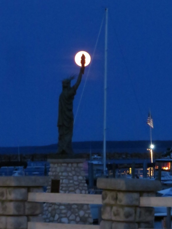 An awesome patriotic shot of Lady Liberty's torch against a full moon over the Mackinac Marina. (Photo: Clark Bloswick)