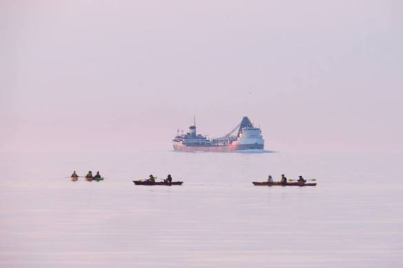 A great shot of kayakers and a freighter from Clark Bloswick.