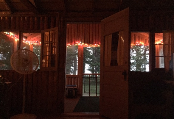 We sleep at night with the cabin wide open and the screened porch aglow with sparkling lights.