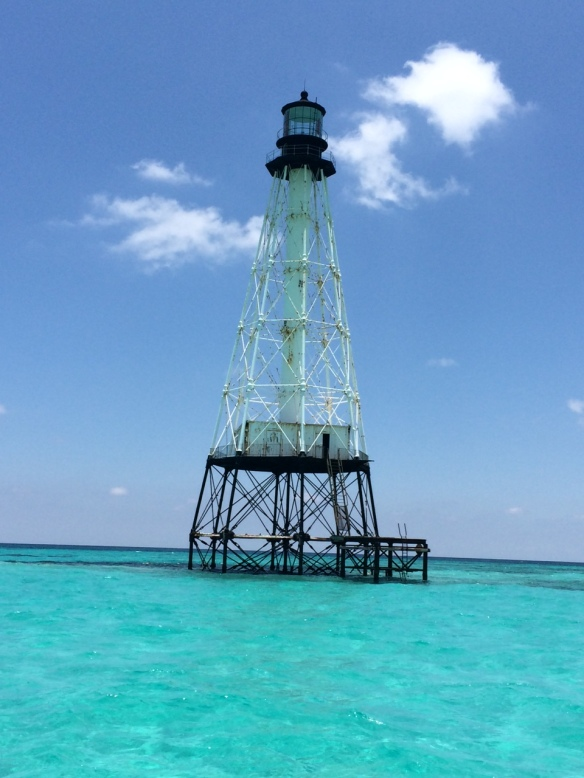 . . . near this lighthouse.  Oh my gosh, that water is beautiful!!