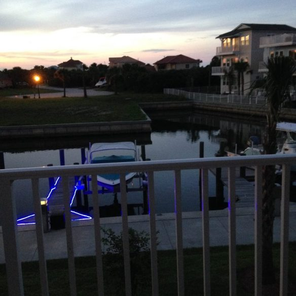 Each neighbor in Sunset Inlet gets a little different angle on our little group of houses.  Jennifer shot this across the canal at sunset.  Our house is