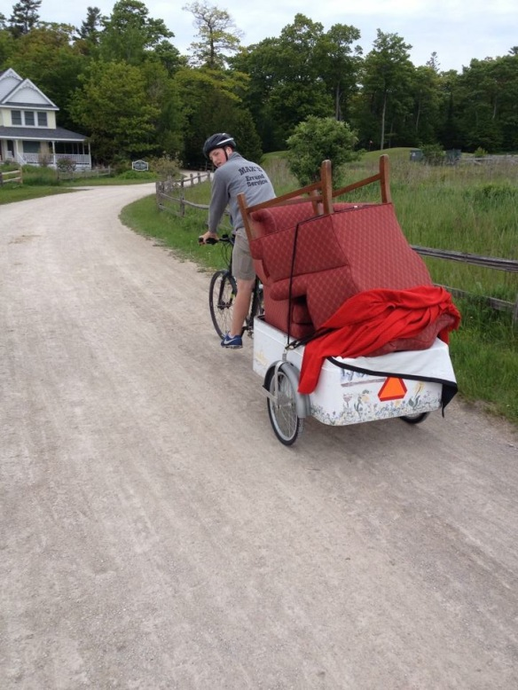 Max - on one of his many daily delivery rides up and down the hills of Mackinac Island.