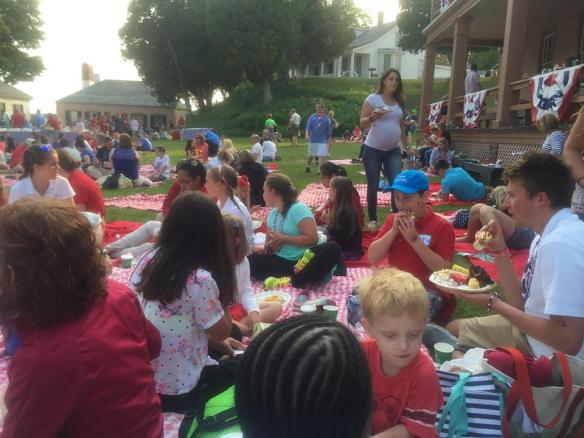 Red and white checked tablecloths are provided by the Grand, and everyone stakes out a piece of lawn where kids can play and everyone can eat from the huge buffet the Grand provides.  (Photo from yesterday's picnic by Mert Vartanian).