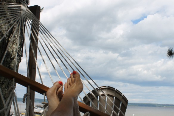 Throw in a hammock tied between two pine trees at the edge of the water . . .