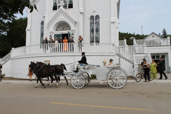 There were a lot of weddings this weekend, and I was in the right place at the right time to capture two brides and grooms as they rode away in the romantic wedding carriages - this one from St. Anne's . . .