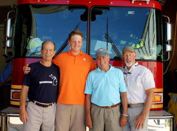 Max with his fellow riders - his dad John, Dr. Steve Humphrey, and Mark Chambers. After the ceremony Max was presented with a special MIFD shirt, making him an honorary MIFD member.