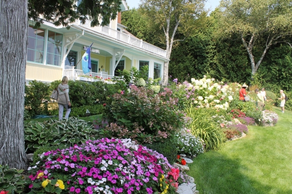 A huge curving expanse of flowers has replaced what was once just a hedge of shrubbery.