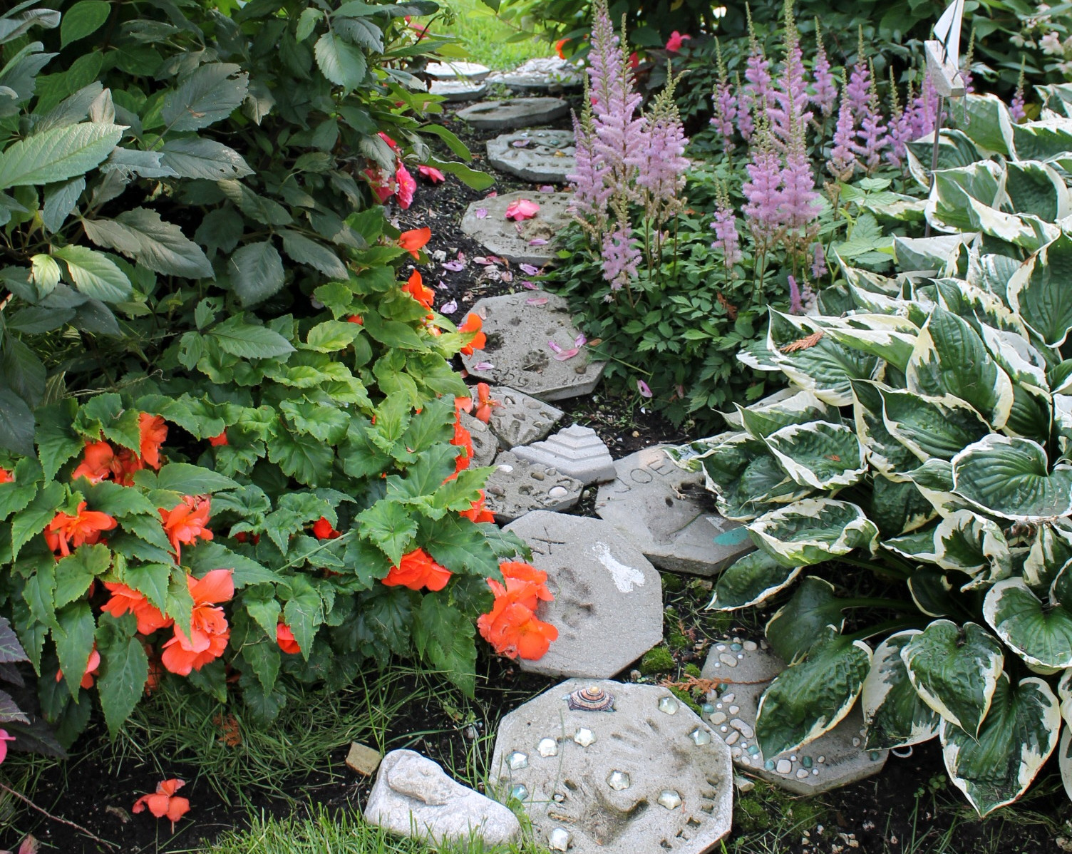A fairy garden path within that swath of flowers. The owners' grandchildren love this.