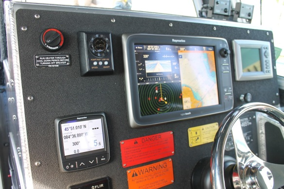 The vessel's control center includes radar, thermal imaging cameras, a Global Positioning System (GPS), and an Automatic Identification System (AIS) used to track marine traffic.