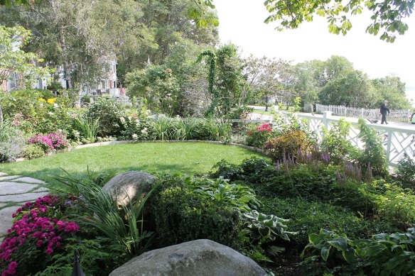 It seemed everything about this home's landscape was about graceful curves . . . the flower beds, the walkway, . . .