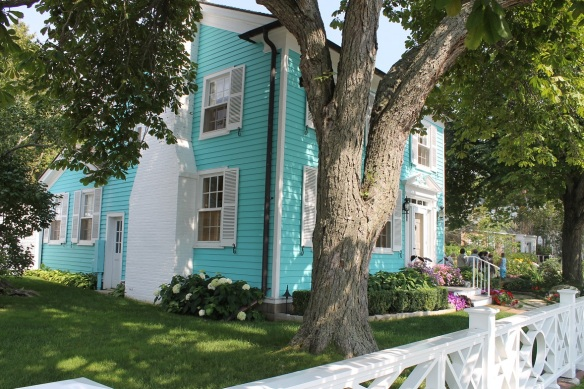 After fortifying ourselves with lunch at the Gatehouse, we headed for our first stop downtown - this beautiful blue cottage on the west end of town.