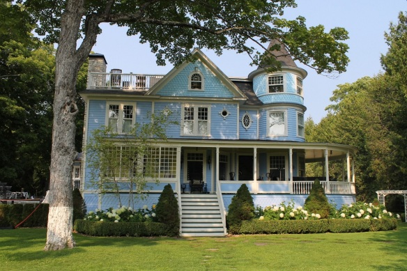 This beautiful blue cottage in the Annex is very grown-up in the front, but in the backyard . . .