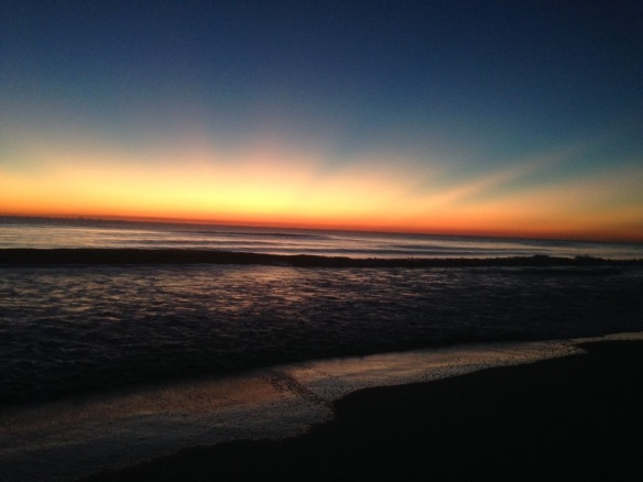 While on an early morning beach walk with the dogs we got to watch God paint the sunrise. Brush strokes of sunlight crept into the dark sky - separating Heaven and earth for another day.