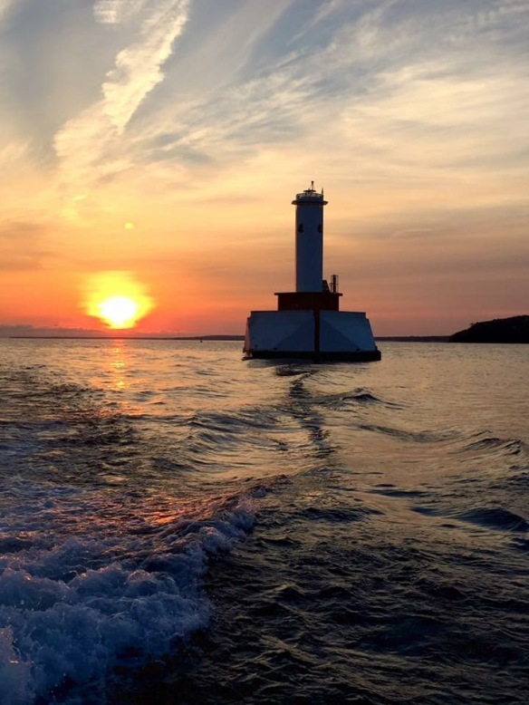 The sun and the Round Island Passage Light by Bobby Lee.