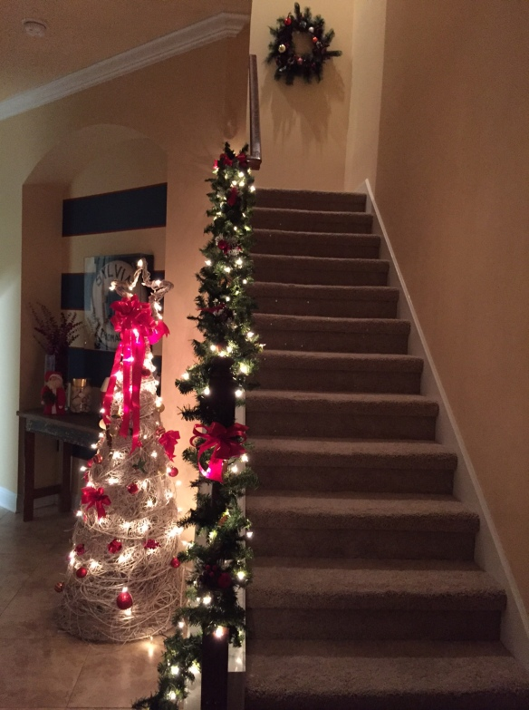 "I've never had a staircase to ""deck"" before, and this year I was ready to give it a try. I used a pre-lit garland from Target and added my own accents from Michael's."