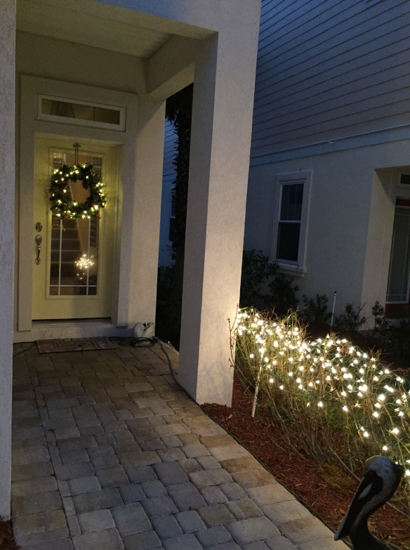 I added the same accents to our pre-lit wreath on the front door . . .