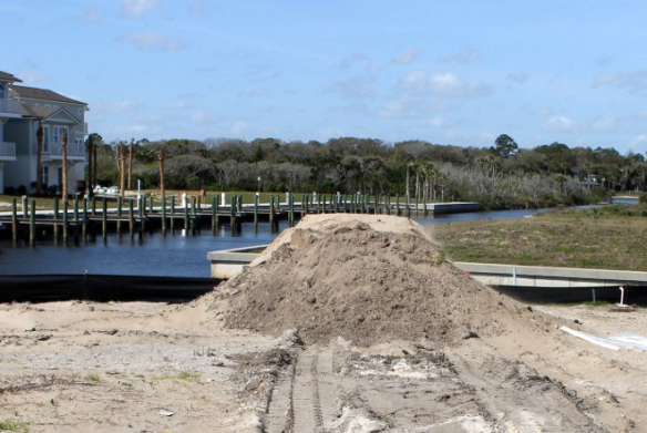 Connecting the Dots - this mound of dirt eventually became part of the foundation for our new home in Sunset Inlet.